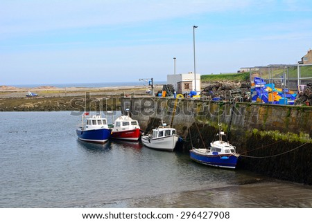 SEAHOUSES, ENGLAND - JUNE 11: Harbour on June 11, 2015 at Seahouses, England. Seahouses is a fishing village so its harbour is lively every day.
