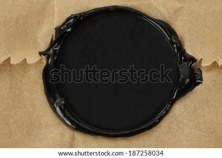 Seal wax on paper bag background  - stock photo