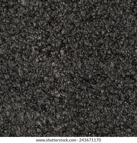 Seamless asphalt texture on new road - stock photo