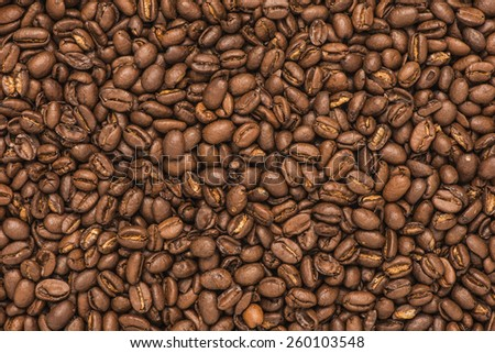 Seamless backdrop of roasted coffee beans. Food background with copyspace. - stock photo