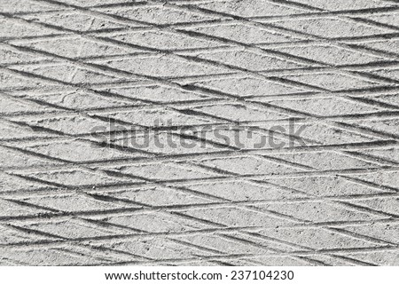 Seamless crosshatched scratched concrete background - stock photo