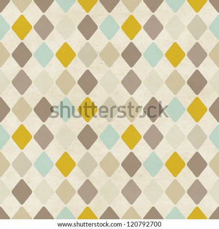 Seamless harlequin pattern on paper texture