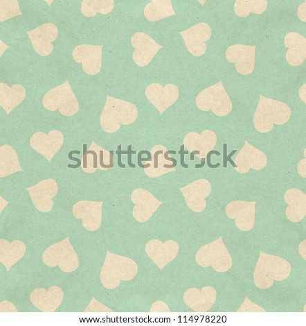Seamless hearts pattern on paper texture - stock photo