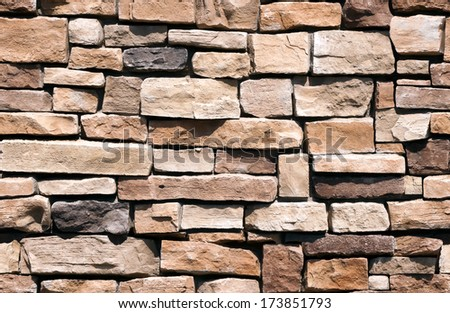 Seamless natural rubble rock wall background, use as stand alone image or as repeating tile.