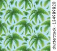 Seamless pattern, green branches with leaves of palm trees on a background of blue sky. - stock vector