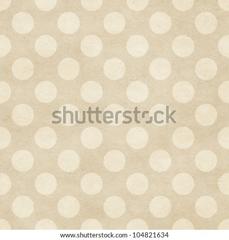 Seamless polka dots pattern on paper texture. - stock photo