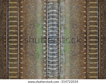 Seamless railroad Pattern, backdrop with space for text. Top view. Shiny iron rails and concrete sleepers, coupled with powerful bolts on stony ground, fortified rubble overgrown with weeds green  - stock photo