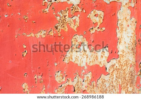seamless red cracked paint grunge on iron background.  texture composition - stock photo