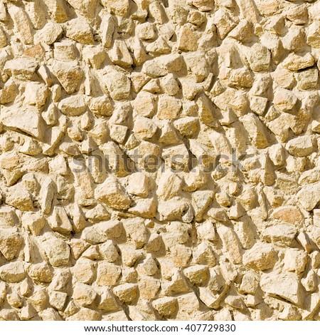 Seamless stony wall background. - stock photo
