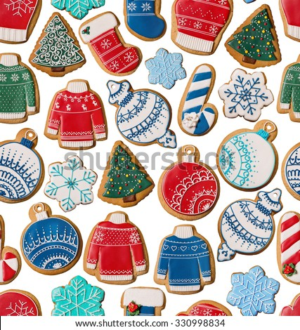 Seamless texture with Christmas gingerbread cookies over white background - stock photo