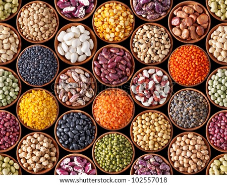Seamless texture with legumes on black background - stock photo