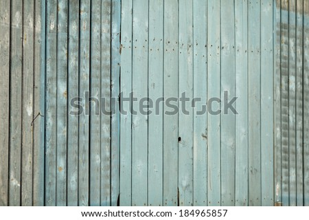 Seamless vertical tiling wood fence texture in blue color