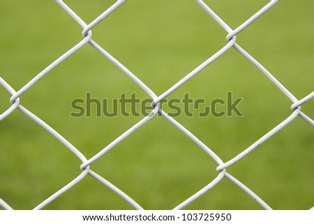 Seamless Wire Fence With Green Field Background - stock photo