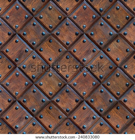 seamless wooden panel door texture with nails - stock photo