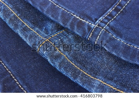 Seams on blue denim trousers on a white background - stock photo