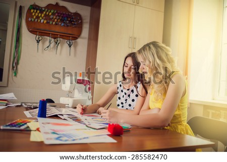 seamstress with the customer working on a dress