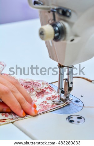 Seamstress working on sewing machine