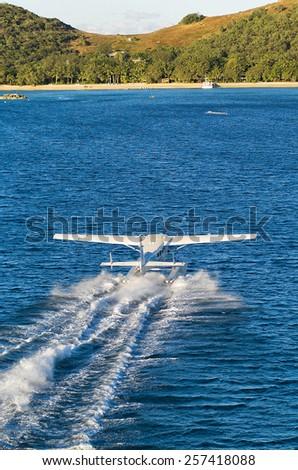Seaplane landing near Orpheus Island off the coast of Queensland, Australia - stock photo