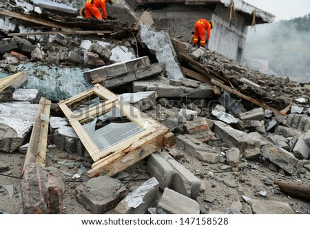Search and rescue forces search through a destroyed building. - stock photo