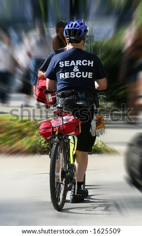 Search and rescue man on bike - stock photo
