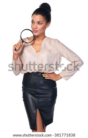 Search concept. Confident business woman standing holding magnifying glass and looking away at blank copy space in contemplation, isolated over white - stock photo