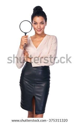 Search concept. Confident business woman standing holding magnifying glass, isolated over white - stock photo