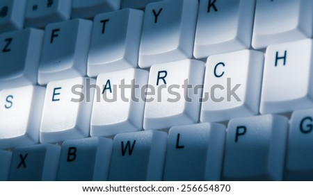 search concept image on computer keyboard with lightray - stock photo