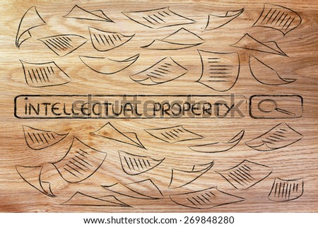 search engine bar surrounded by messy documents, reading about intellectual property - stock photo