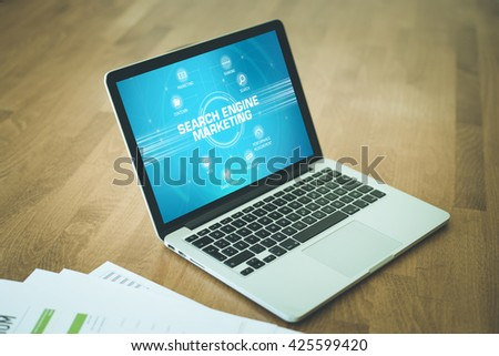 SEARCH ENGINE MARKETING chart with keywords and icons on screen - stock photo