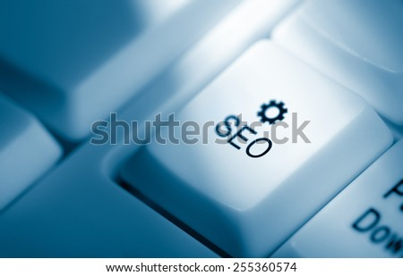 Search engine optimization concept image. Blue toned keyboard with SEO and icon - stock photo