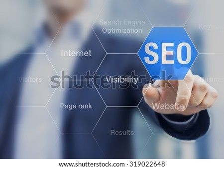 Search Engine Optimization consultant touching SEO button on whiteboard - stock photo