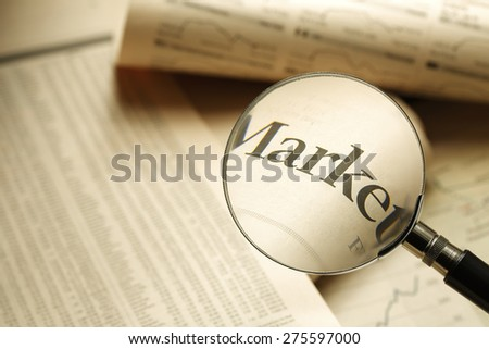 Search for financial market information with a magnifying  - stock photo