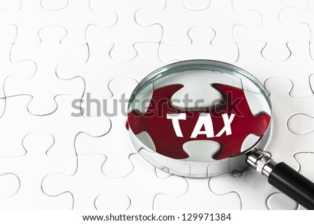 "Search for missing puzzle pieces ""TAX"" with a magnifying glass"