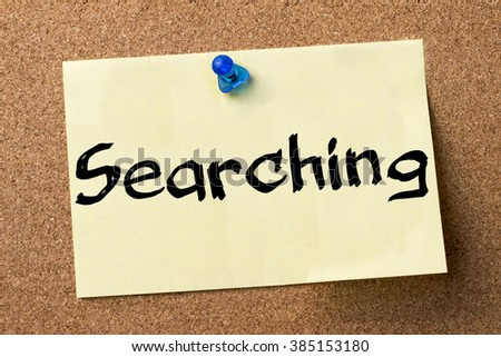 Searching - adhesive label pinned on bulletin board - horizontal image - stock photo