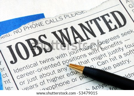 Searching for a job from a newspaper - stock photo