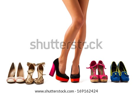Searching for a perfect pair of shoes - stock photo