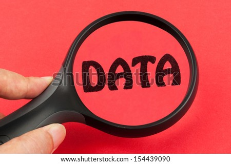 Searching in Data concept using a magnifier - stock photo