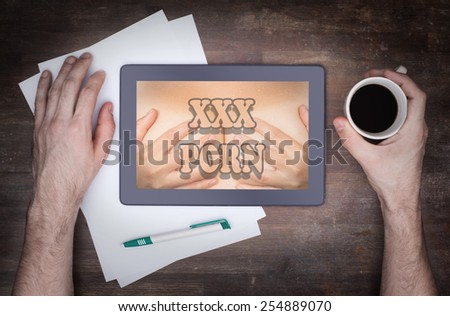 Searching online for porn, XXX on a tablet - stock photo
