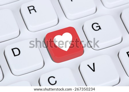 Searching partner and love online on digital internet dating computer - stock photo