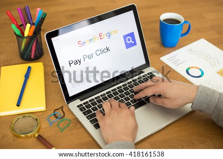 Searching PAY PER CLICK on Internet Search Engine Browser Concept - stock photo