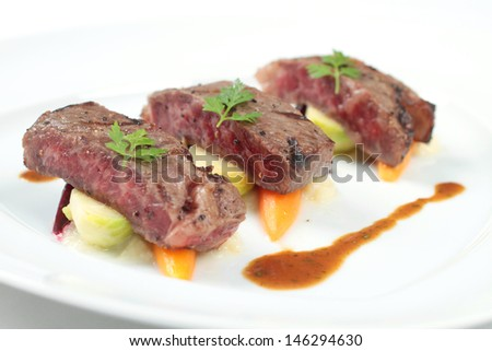 Seared steak chunks served fine dining style