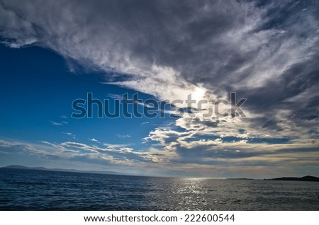 Seascape and cloudscape after summer storm near small greek village Toroni, Sithonia, Greece - stock photo