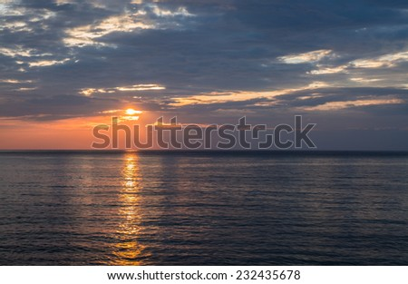 Seascape and cloudy sky before sunset - stock photo