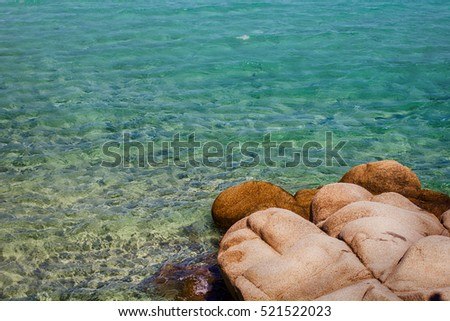 Seascape and rocks shore, beautiful turquoise sea on the summer day.