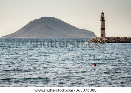 Seascape and the lighthouse on the coast in Bodrum, Turkey - stock photo