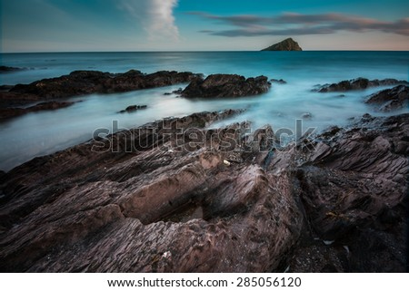 Seascape at twilight, with long exposure at rocky Wembury Beach,Devon - stock photo