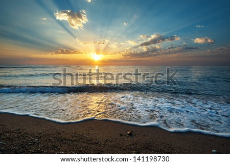 Seascape background with clouds and waves  on sunrise - stock photo