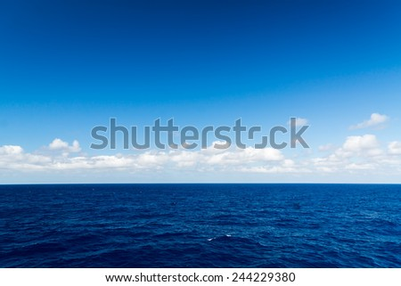 Seascape. Blue sky and white cloud. Calm sea. - stock photo