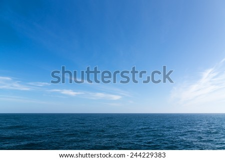Seascape. Blue sky and white cloud. Calm sea.