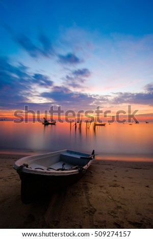 Seascape boat on the beach background sunset, Pattaya in Thailand.